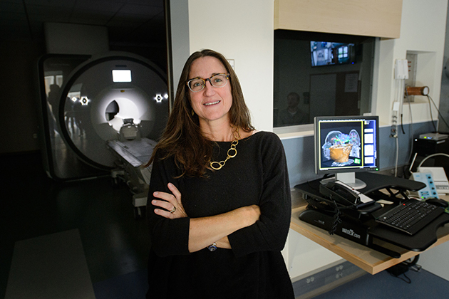 Inge-Marie Eigsti with the new FMRI at the Brain and Imaging Center on Sept. 28, 2015. (Peter Morenus/UConn Photo)